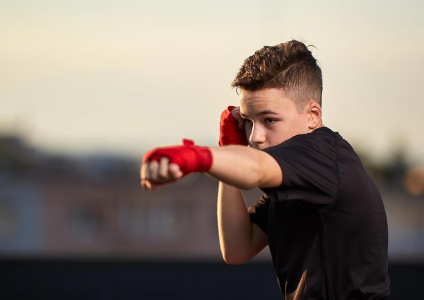 Young teen boy practising his boxing stance